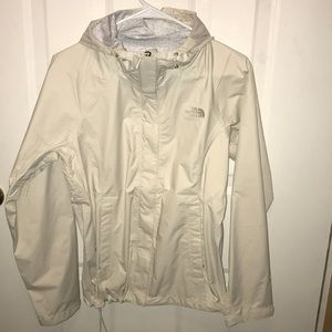while/cream northface jacket